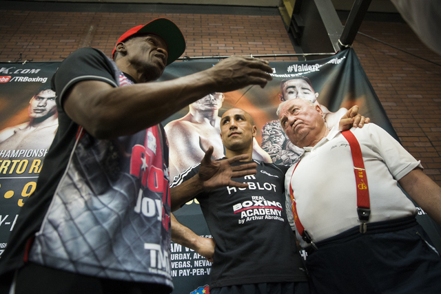 Arthur Abraham, middle, and trainer Ulli Wegner, right, listen to Floyd Mayweather, Sr. on Monday, April 4, 2016, in Las Vegas. Abraham will defend his title against Gilberto Ramirez Saturday nigh ...