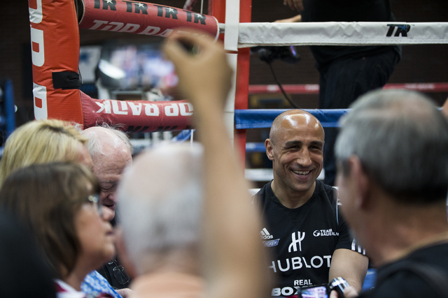 Arthur Abraham, the WBO super middleweight title holder at 168 pounds, shares a laugh with reporters at Top Rank Gym Monday, April 4, 2016, in Las Vegas. Abraham will defend his title against Gilb ...