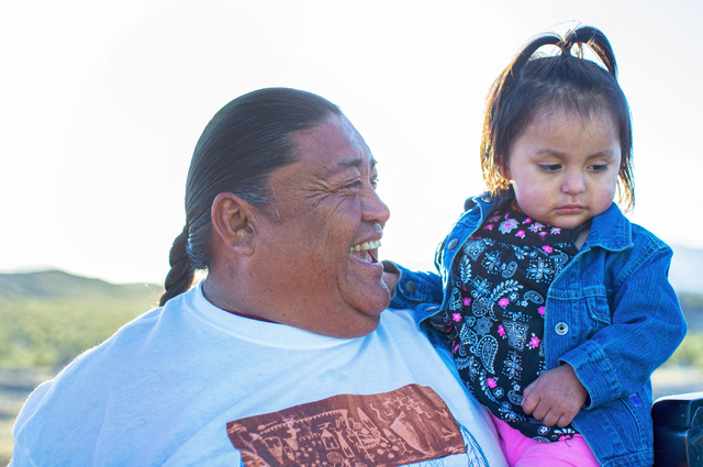 Greg Anderson, left, with niece Morningdove Clark, 2, at the site of the Gold Butte Culture Walk, Saturday, April 23, 2016, in Gold Butte, Nevada. The fourth annual event is aimed at promoting the ...