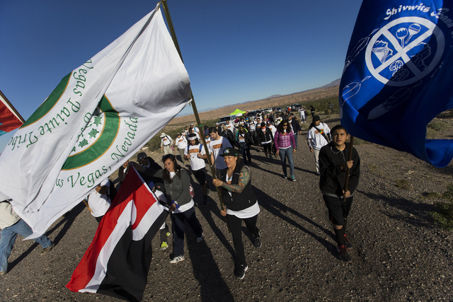 Attendees of the Gold Butte Culture Walk start the 11-mile hike to promote the need for a national monument for Gold Butte, which is a sacred area to the Southern Paiute people, on Saturday, April ...