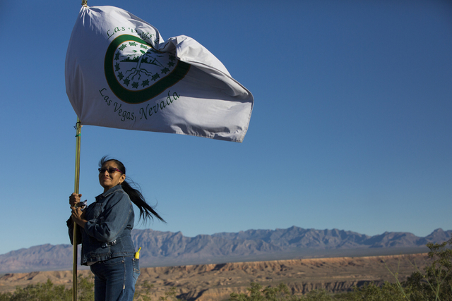 Linda Rae Linero holds the Las Vegas Paiute Tribe flag before the start of the Gold Butte Culture Walk, Saturday, April 23, 2016, in Gold Butte, Nevada. The fourth annual event is aimed at promoti ...