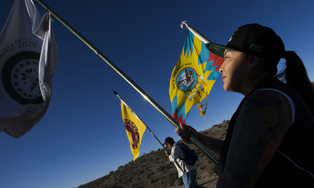 Fawn Douglas, a member of the Las Vegas Paiute Tribe, holds her tribe's flag during the Gold Butte Culture Walk, Saturday, April 23, 2016, in Gold Butte, Nevada. The fourth annual event is aimed a ...