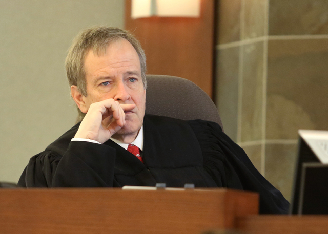 Judge Eric Johnson listens to opening statements in the trial of Mark Picozzi in Clark County District Court at Regional Justice Center Wednesday, April 13, 2016, in Las Vegas. (Ronda Churchill/La ...