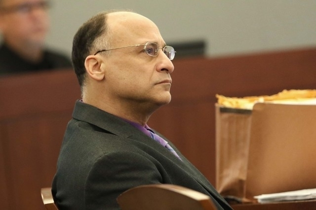 Mark Picozzi is on trial for impersonating a police officer and sexually assaulting sex workers, in Clark County District Court, Wednesday, April 13, 2016, in Las Vegas. (Ronda Churchill/Las Vegas ...