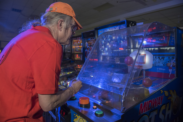 Pinball Hall of Fame owner Tim Arnold, plays Midway's Hot Shot, a basketball game, at his museum at 1610 E. Tropicana Ave. in Las Vegas on Thursday, April 14, 2016. (Martin S. Fuentes/Las Vegas Re ...