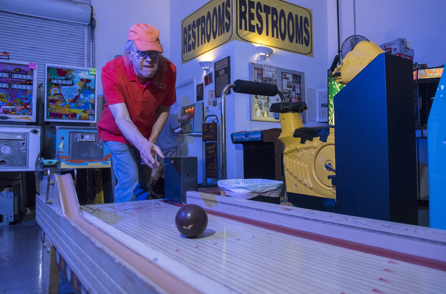 Pinball Hall of Fame owner Tim Arnold, plays an bowling game at his museum at 1610 E. Tropicana Ave. in Las Vegas on Thursday, April 14, 2016. (Martin S. Fuentes/Las Vegas Review-Journal)