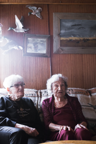Lina Sharp, 96, left, and Minnie Perchetti, 95, reminisce on what their lives were like before television during a visit at Perchetti's home in Tonopah, Nev. on Friday, April 8, 2016. They have be ...