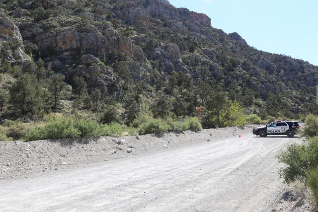 Police block the road at the scene of a shooting near Mount Potosi Monday, April 4, 2016. Rachel Aston/Las Vegas Review Journal Follow @rookie__rae