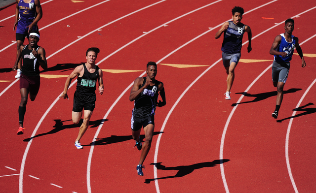 Silverado runner Zakee Washington, center, races to a winning time of 48.64 seconds in the 400 meter dash at the Skyhawk Invitational track and field meet at Silverado High School in Henderson Sat ...