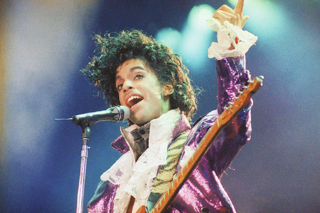 FILE - In this Feb. 18, 1985 file photo, Prince performs at the Forum in Inglewood, Calif. Prince, widely acclaimed as one of the most inventive and influential musicians of his era with hits incl ...