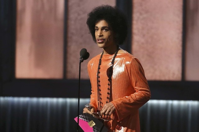 Prince presents the award for album of the year at the 57th annual Grammy Awards in Los Angeles, Feb. 8, 2015. (Lucy Nicholson/Reuters)