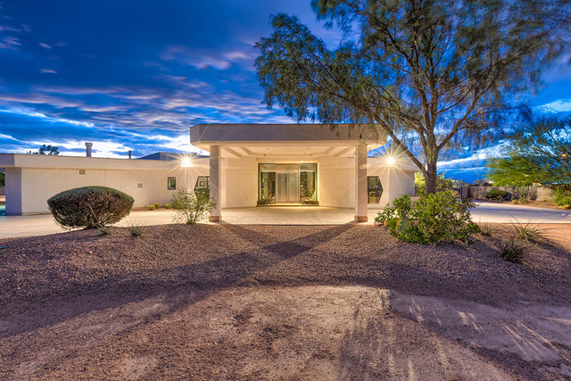 The home has three control panels and five keypads throughout to control the lighting, HVAC, skylight, pool, spa and waterfall, window wall shades, garage doors, audio-visual system, cameras and a ...