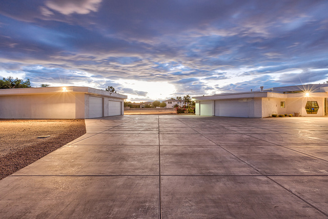 A three-car attached garage and 1,600-square-foot, free-standing garage with a half-bath surround the home, which sits on two acres and has an undeveloped acre. (COURTESY OF LUXE ESTATES & LIF ...