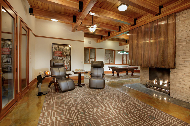 The game room has a fireplace. (Synergy Sotheby's International Realty)