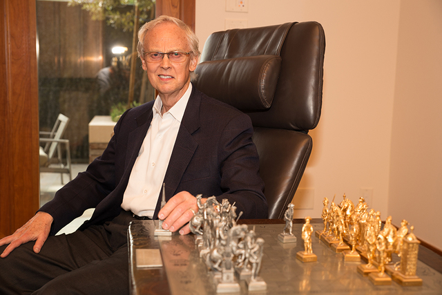 John Gubler, a Las Vegas Valley attorney of 45 years, at his Summerlin home with his U.S. Bicentennial chess set (TONYA HARVEY/REAL ESTATE MILLIONS)