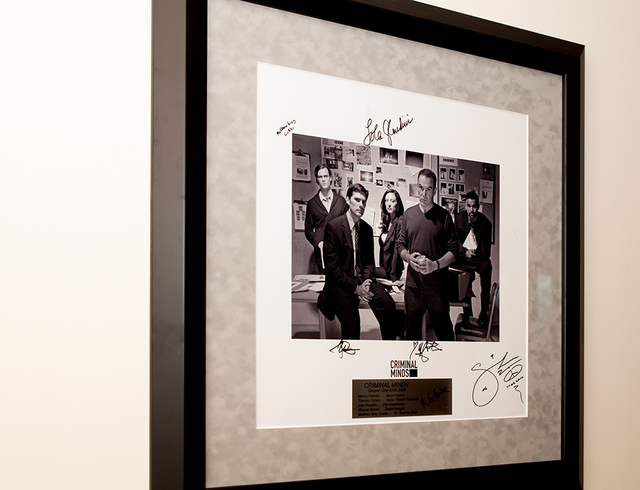 "A signed framed autographed photograph of ""Criminal Minds'""' first season cast. (TONYA HARVEY/REAL ESTATE MILLIONS)"