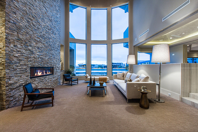 The home has a floor-to-ceiling brick fireplace. (Courtesy Shapiro & Sher Group)