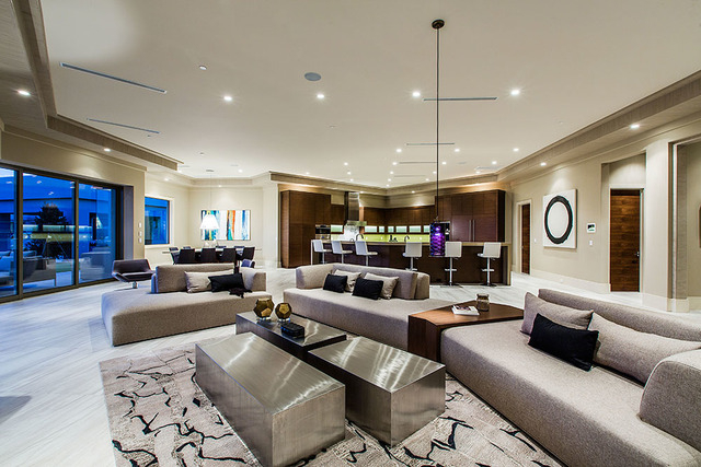 The large living area has a bar. (Courtesy Shapiro & Sher Group)