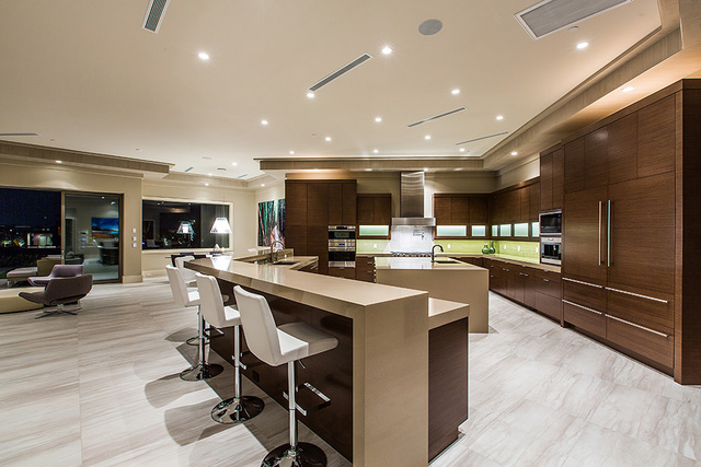The kitchen has a large island with seating. (Courtesy Shapiro & Sher Group)