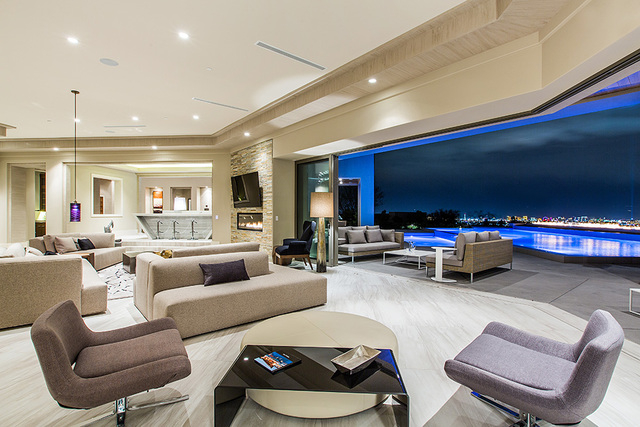 The living area is connected to an outdoor patio. (Courtesy Shapiro & Sher Group)