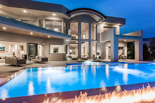 The home features a large pool with a fire feature.  (Courtesy Shapiro & Sher Group)