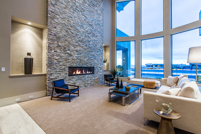 The living room features a horizontal fireplace. (Courtesy Shapiro & Sher Group)