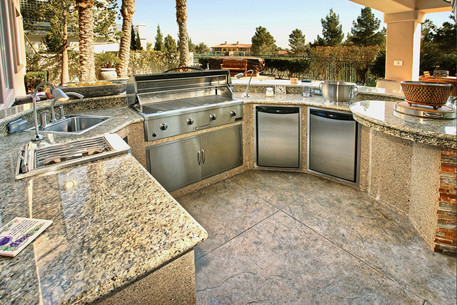 Lots of Las Vegans spend a lot of time outdoor at the pool in the summers. Many homes in all price ranges are adding outdoor ktichens. (COURTESY OF LAGUNA POOL, SPA & LANDSCAPING)