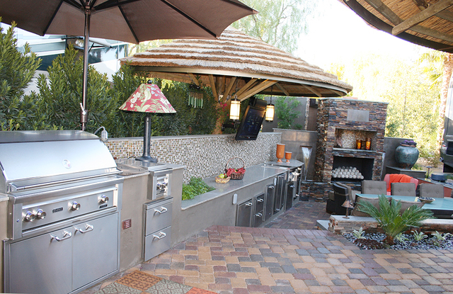 Many outdoor kitchens have fireplaces. (COURTESY OF LAGUNA POOL, SPA & LANDSCAPING)