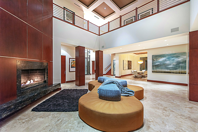 A sitting area near the fireplace is off the entrance. (Courtesy Simply Vegas)