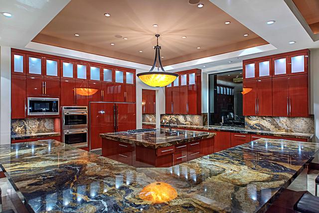 The kitchen has a center island. (Courtesy Simply Vegas)