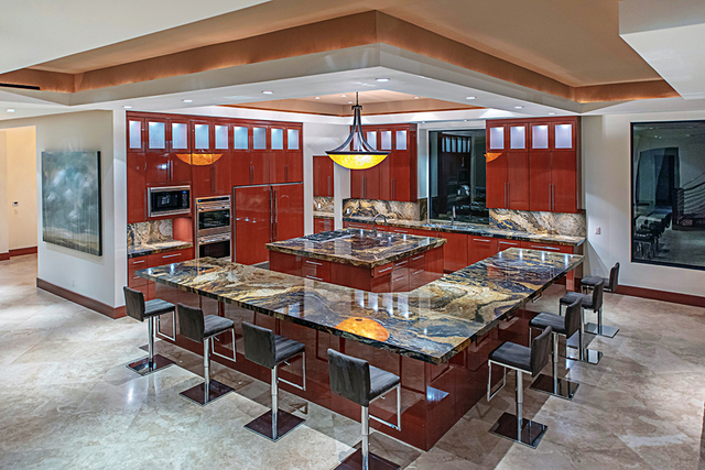 The kitchen is connected to the large downstairs living area. (Courtesy Simply Vegas)