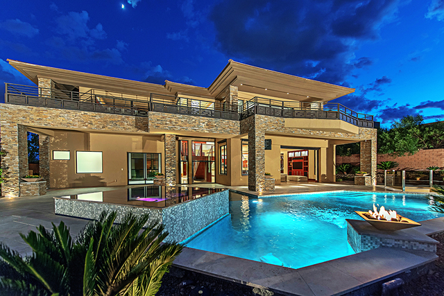 The home's backyard has a pool, spa and fire feature. (Courtesy Simply Vegas)