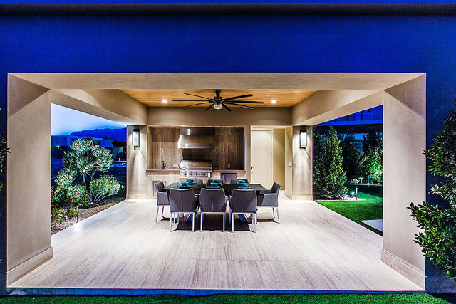 This Ridges home in Summerlin features an outdoor kitchen with a seating area. (COURTESY OF SHAPIRO & SHER GROUP)