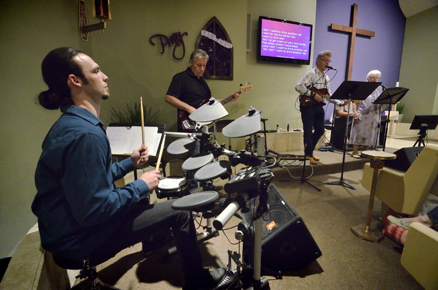 "Drummer Sam Friend, left, performs with the rest of the Honkey Tonk Angels during the ""Country Western Gospel Service"" at Community Lutheran Church at 3720 E. Tropicana Ave. in Las V ..."