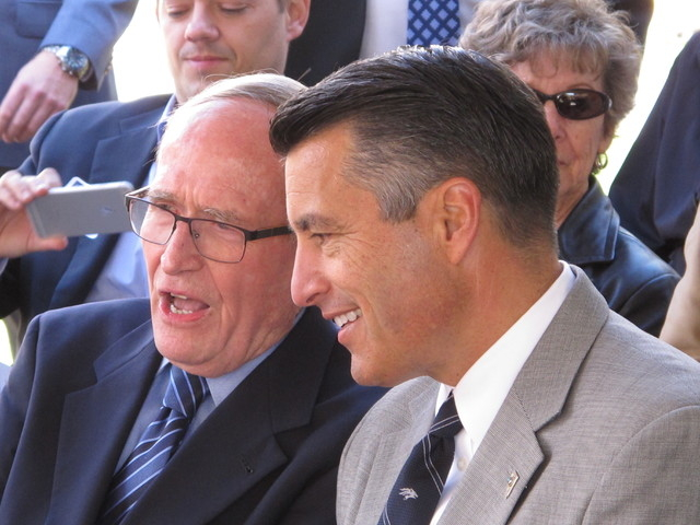 Longtime former U.S. Sen. and Nevada Gov. Richard Bryan, left, chats with Gov. Brian Sandoval on the campus of the University of Nevada, Reno, on Friday, April 29, 2016.  (Scott Sonner/The Associa ...