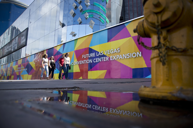 Pedestrians walk by advertising for the expansion of the Las Vegas Convention Center outside the shuttered Riviera hotel-casino on the Las Vegas Strip on Tuesday, March 29, 2016. Daniel Clark/Las  ...