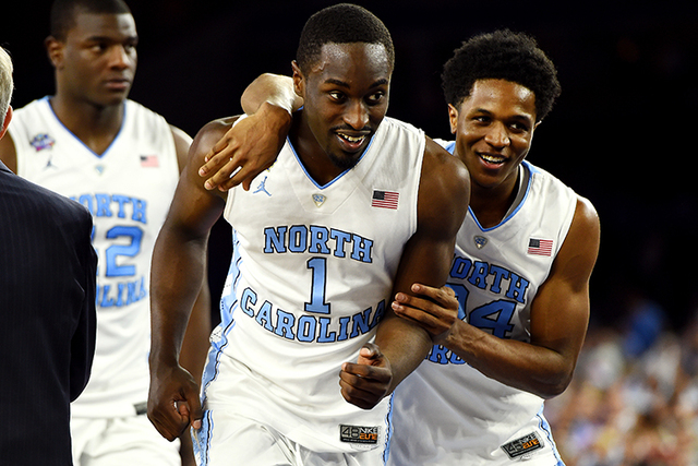 North Carolina Tar Heels forward Theo Pinson (1) and North Carolina Tar Heels guard Kenny Williams (24) react after the game against the Syracuse Orange in the 2016 NCAA Men's Division I Champions ...