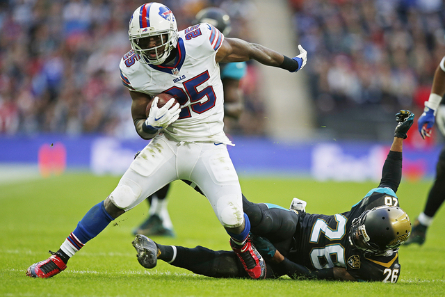 Jacksonville Jaguars' Josh Evans in action with Buffalo Bills' LeSean McCoy (L) during the NFL International Series at Wembley Stadium in London, England on Oct. 25, 2015. (Action Images via Reute ...