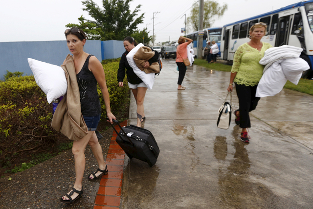 Tourists arrive at the University of Puerto Vallarta after being evacuated from their hotel last October as Hurricane Patricia approached the Mexican resort town. (Henry Romero/Reuters)