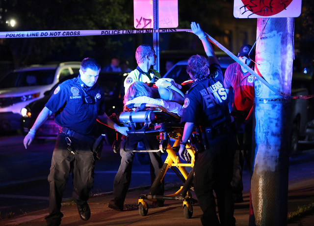 Paramedics with New Orleans EMS transport Racquel Smith, wife of former New Orleans Saints' Will Smith, following a shooting in New Orleans late Saturday, April 9, 2016. (Michael DeMocker/NOLA.com ...