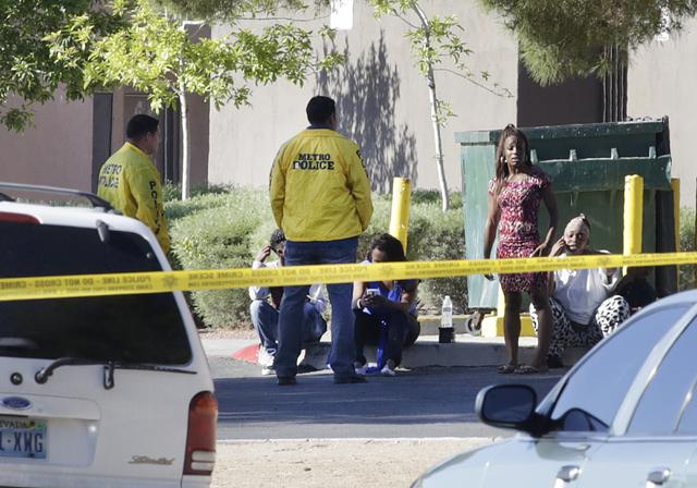 Metro police officers talk to residents as they investigate a homicide after a person was shot and killed early Tuesday, April 19, 2016, at 1416 Sandhill Road. (Bizuayehu Tesfaye/Las Vegas Review- ...