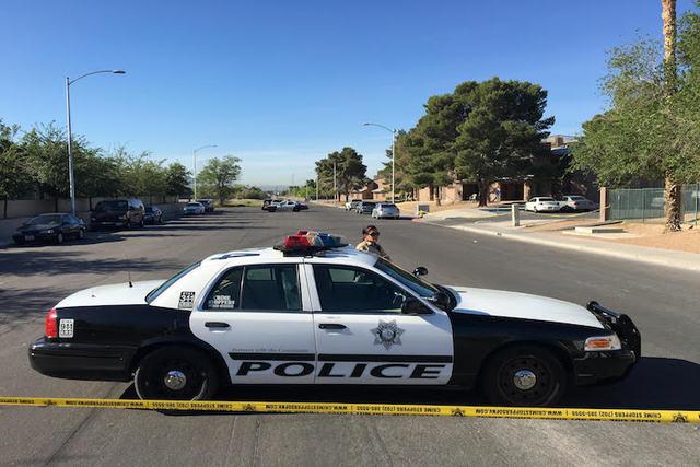 Metro investigates a homicide at 1416 Sandhill Road, Tuesday, April 19, 2016. (Bizuayehu Tesfaye/ Las Vegas Review-Journal)