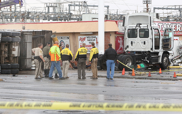 Metro investigates a fatal accident involving a tractor-trailer at the intersection of Nellis Boulevard and Washington Avenue, Monday, April 25, 2016. (Bizuayehu Tesfaye/Las Vegas Review-Journal F ...