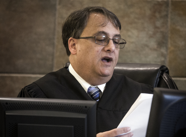 District Judge Richard Scotti reads jury instructions during the Robert Sharpe III  trial in Regional Justice Center on Friday, March 11, 2016. Sharpe is accused of brutally beating one of his pro ...