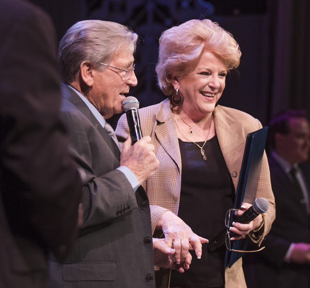 Comedian Shecky Greene holds hands with Las Vegas Mayor Carolyn Goodman while she presenting him with the Key to the City during Conversations with Norm in the Jazz Cabaret at The Smith Center on  ...