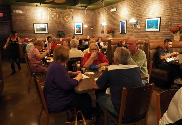 Patrons enjoy their dinners at Shucks Tavern, 7155 N. Durango Dr., in Las Vegas on Friday, April 1, 2016. Jerry Henkel/Las Vegas Review-Journal