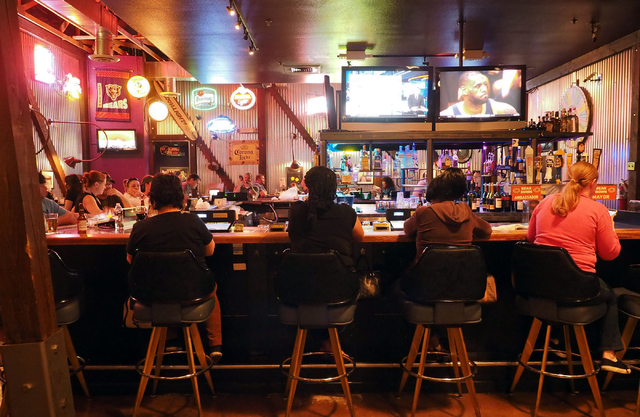 Patrons sit at the bar and enjoy their dinners at Shucks Tavern, 7155 N. Durango Dr., in Las Vegas on Friday, April 1, 2016. Jerry Henkel/Las Vegas Review-Journal