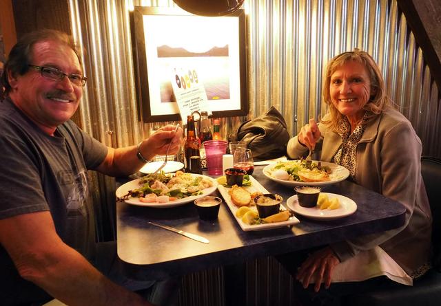 Glenn and Jennifer Hansen of Las Vegas enjoy their dinners of seafood louie salad with a calamari appetizer at Shucks Tavern, 7155 N. Durango Dr., in Las Vegas on Friday, April 1, 2016. Jerry Henk ...