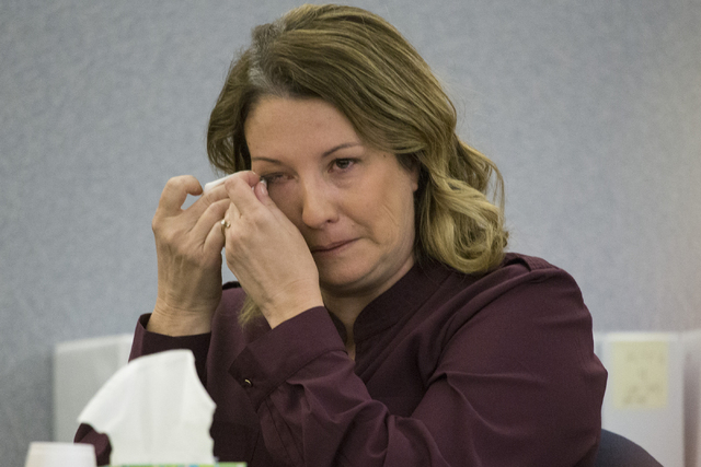 Kelly Hendrickson wipes tears while testifying in court about her slip and fall while at Lowe's home improvement store at the Regional Justice Center on Thursday, April 7, 2016, in Las Vegas. (Eri ...