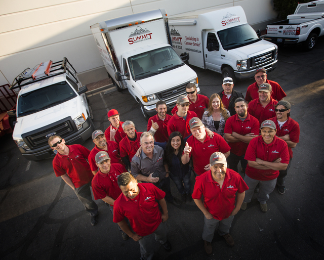 The staff of Summit Restoration and Everest Construction stand for a photo on Friday, March 25, 2016. Jeff Scheid/Las Vegas Review-Journal Follow @jlscheid